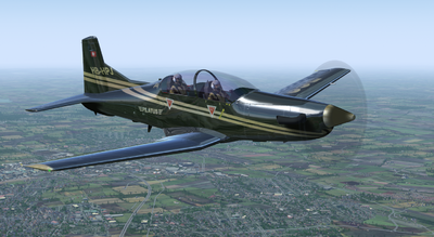 Pilatus PC-9M in reflective factory demonstrator livery